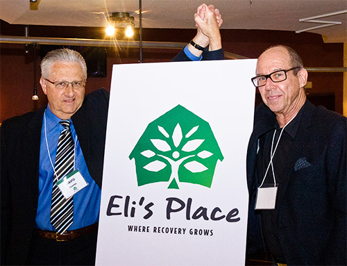 Eli's Place Co-founder and Chairman David Cooper (L) celebrates with Lorne Bernstein, Fundraising Chair